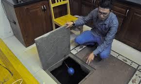 Thau rửa bể nước tại Trần Cung